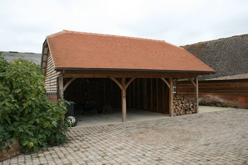 Two bay carport with log store